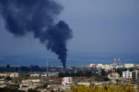 Smoke rises from an oil facility in the southern town of Zahrani, south of the port city of Sidon, Lebanon, Monday, Oct. 11, 2021. A huge fire broke out at an oil facility in southern Lebanon's coastal town of Zahrani, but the cause was not immediately known. (AP Photo/Hassan Ammar)