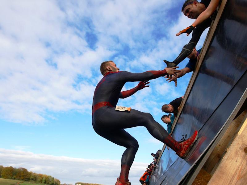 Competitors participate in the Tough Mudder challenge near Winchester in southern England October 25, 2014.