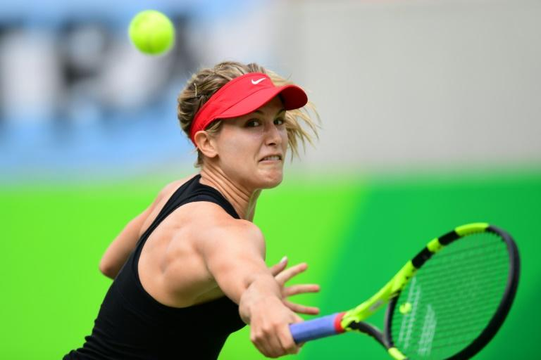 Lawsuit pending, Bouchard out at US Open; Serena, Venus win