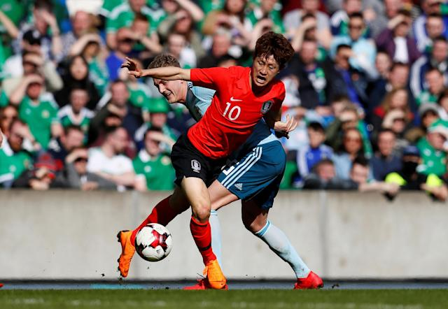 Soccer Football - International Friendly - Northern Ireland vs South Korea - National Football Stadium at Windsor Park, Belfast, Britain - March 24, 2018 South Korea's Jae-Sung Lee in action with Northern Ireland's George Saville Action Images via Reuters/Jason Cairnduff