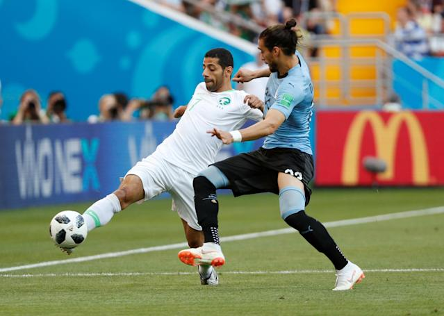 Soccer Football - World Cup - Group A - Uruguay vs Saudi Arabia - Rostov Arena, Rostov-on-Don, Russia - June 20, 2018 Saudi Arabia's Taisir Al-Jassim in action with Uruguay's Martin Caceres REUTERS/Max Rossi