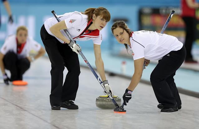 Great Britain's Claire Hamilton, right, and Anna Sloan, right, sweep the ice during the women's curling competition against Sweden at the 2014 Winter Olympics, Monday, Feb. 10, 2014, in Sochi, Russia. (AP Photo/Wong Maye-E)