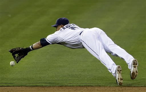San Diego Padres shortstop Everth Cabrera misses a diving catch on a hit for a single by St. Louis Cardinals' Yadier Molina during the third inning of their baseball game Wednesday, May 22, 2013, in San Diego. (AP Photo/Gregory Bull)
