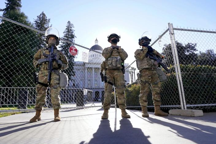 """<span class=""""caption"""">The Second Amendment declares the importance of state-government authorized militias, like these National Guard troops guarding the California State Capitol building.</span> <span class=""""attribution""""><a class=""""link rapid-noclick-resp"""" href=""""https://newsroom.ap.org/detail/CaliforniaGovernor-ThreatInvestigation/bcc5077a59904172915907871d881914/photo"""" rel=""""nofollow noopener"""" target=""""_blank"""" data-ylk=""""slk:AP Photo/Rich Pedroncelli"""">AP Photo/Rich Pedroncelli</a></span>"""