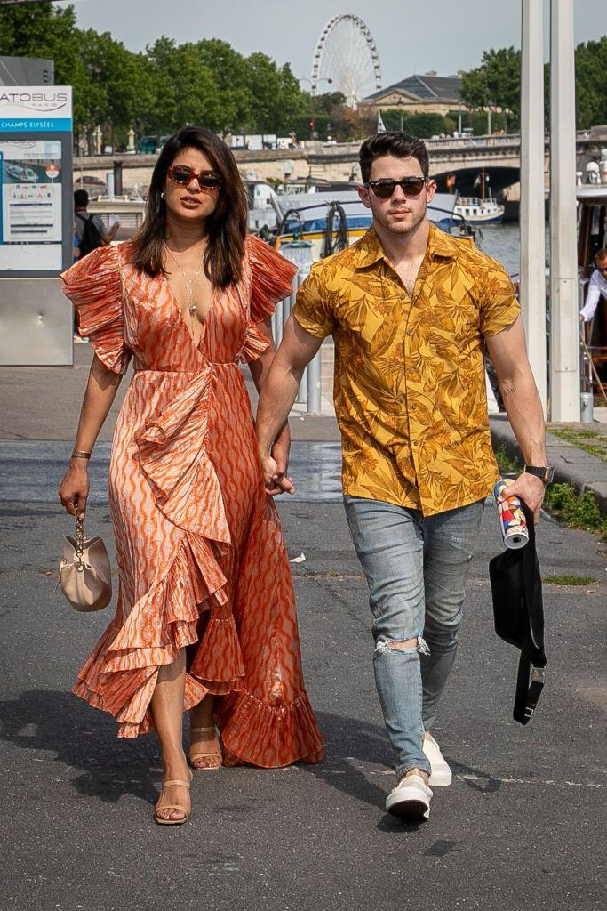 <p>Opting for bright patterns and colours for a walk by the River Seine, ahead of Sophie Turner's French wedding.</p>