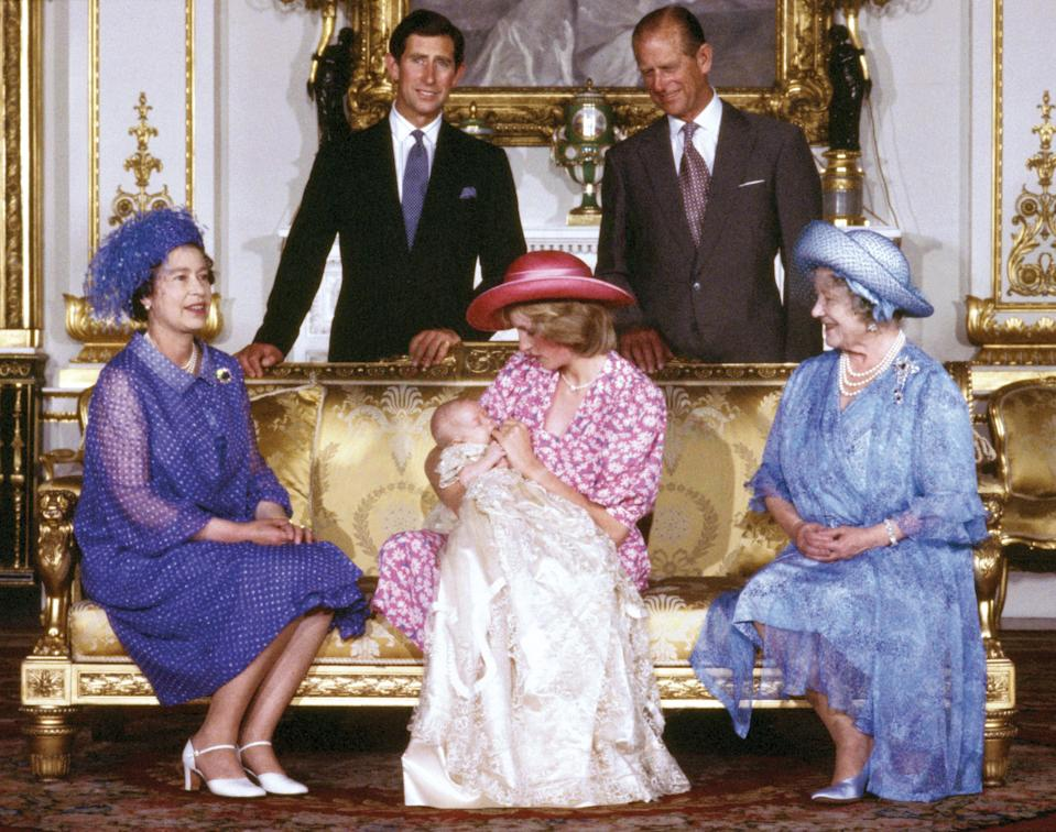 The Queen and Prince Philip together with the Queen Mother, Prince Charles, and Princess Diana holding a young Prince William. The prince is second in line to the throne, after his father, Prince Charles.