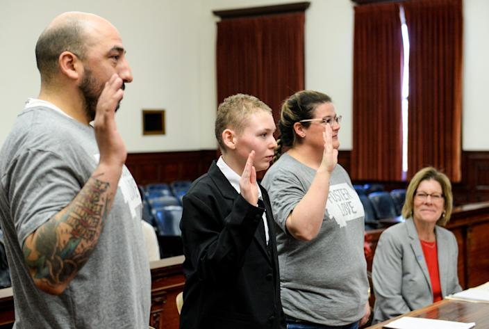 Alexander Reyes, age 12, is sworn in along with his adoptive parents Philip and Pamela Reyes on Friday during a Star Wars-themed adoption ceremony performed by Judge Greg Pinski in the Cascade County Courthouse.