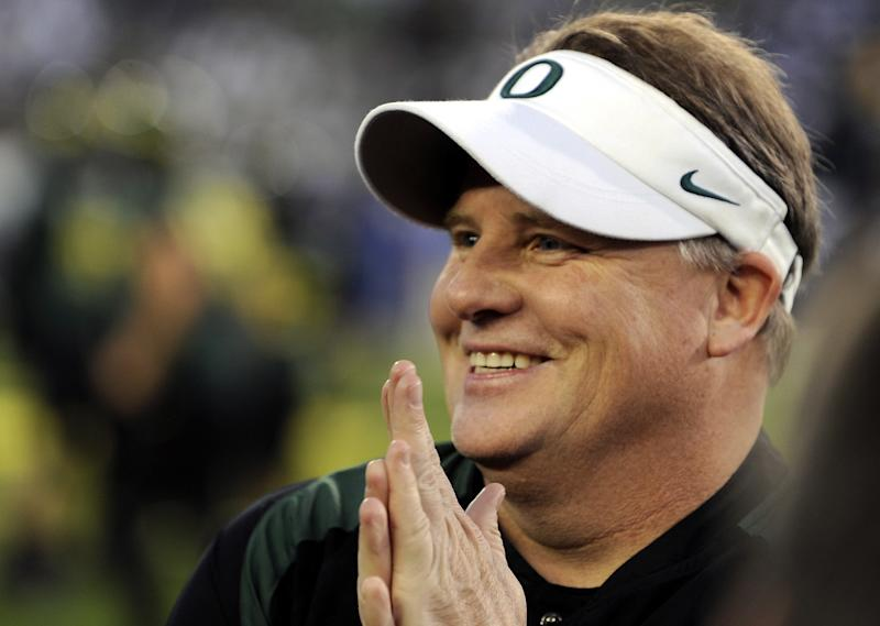 FILE - In this Dec. 2, 2011 file photo, Oregon's head coach Chip Kelly smiles before the Pac 12 championship football game against UCLA in Eugene, Ore. The Philadelphia Eagles have hired Kelly after he originally chose to stay at Oregon. Kelly becomes the 21st coach in team history and replaces Andy Reid, who was fired on Dec. 31 after a 4-12 season. (AP Photo/Greg Wahl-Stephens, File)