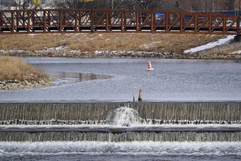 A section of the Flint River is shown in Flint, Mich., Wednesday, Jan. 13, 2021. Some Flint residents impacted by months of lead-tainted water are looking past expected charges against former Gov. Rick Snyder and others in his administration to healing physical and emotional damages left by the crisis. (AP Photo/Paul Sancya)