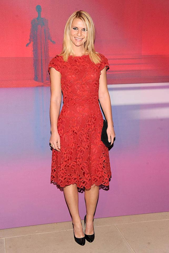 "The rain couldn't keep Claire Danes from coming out to celebrate Valentino's big night! The ""Homeland"" star sported a lacy red dress from his Spring 2012 collection for the occasion. (12/07/2011)"
