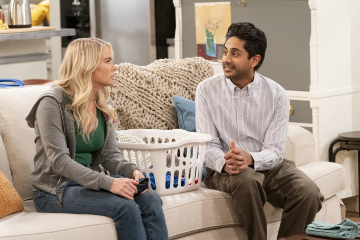 """In this image provided by CBS, Kelli Goss, left, as Vanessa, and Adhir Kalyan as Al, appear in a scene from """"United States of Al."""" (Robert Voets/CBS via AP)"""