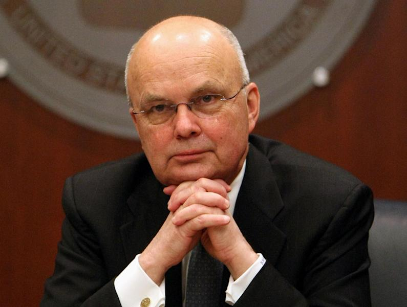 FILE - This Jan. 15, 2009, file photo shows then-CIA Director Michael Hayden, and a former National Security Agency (NSA) chief, participating in a news conference at CIA headquarters in Langley, Va. At the center of a hotly disputed Senate torture report is America's biggest counterterrorism success of all: the killing of Osama bin Laden. The still-classified, 6,200-page review concludes that waterboarding and other harsh interrogation methods provided no key evidence in the hunt for bin Laden, according to congressional aides and outside experts familiar with the investigation. The CIA still disputes that conclusion. (AP Photo/Luis M. Alvarez, File)