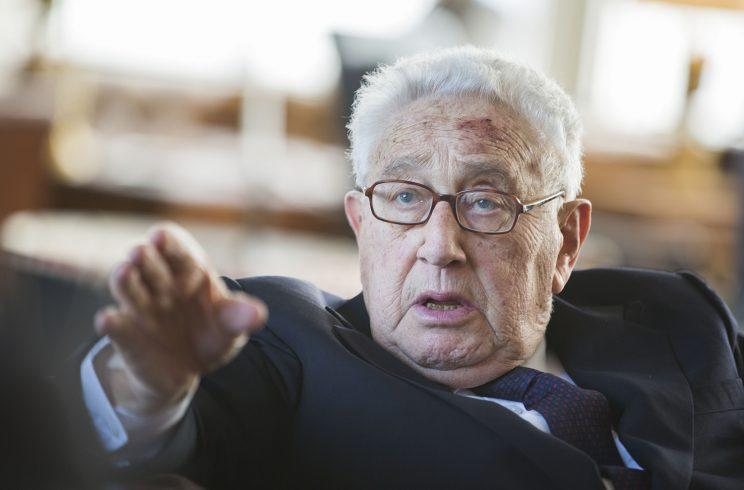 Former US Secretary of State Henry Kissinger gestures during a birthday reception for his 90th birthday in Berlin, Germany, June 11, 2013. The reception was held by German multimedia company Axel Springer AG. Kissinger was born May 27, 1923. (AP Photo/Gero Breloer)