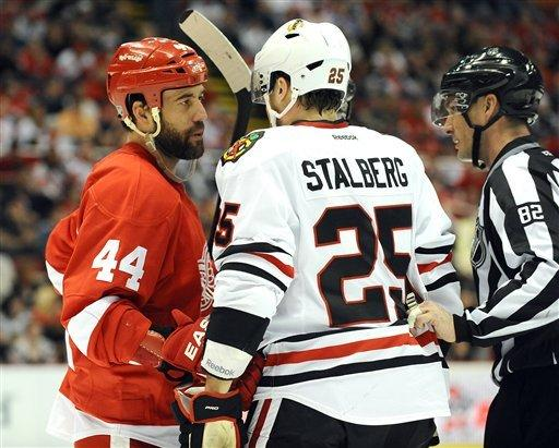 Chicago Blackhawks right winger Viktor Stalberg, right, and Detroit Red Wings right winger Todd Bertuzzi, exchange pleasantries during the first period of an NHL hockey game at Joe Louis Arena in Detroit, Saturday afternoon, April 7, 2012. The Blackhawks won 3-2 in a shootout. (AP Photo/Lon Horwedel)