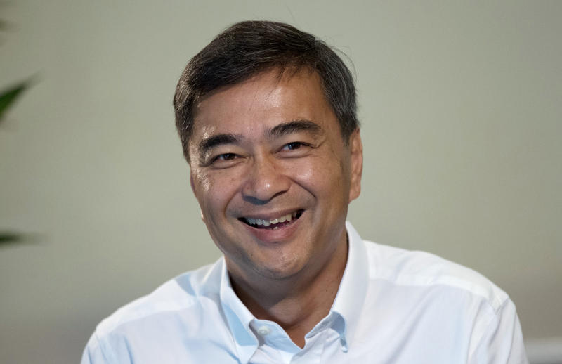 The leader of Thailand's Democrat Party Abhisit Vejjajiva talks to The Associated Press reporters during an interview Wednesday, March 20, 2019. in Bangkok, Thailand. Abhisit says if he becomes prime minister after Sunday's election, he'll make careful but forceful efforts to undo undemocratic constitutional clauses imposed by the military government that took power in 2014. (AP Photo/Sakchai Lalit)