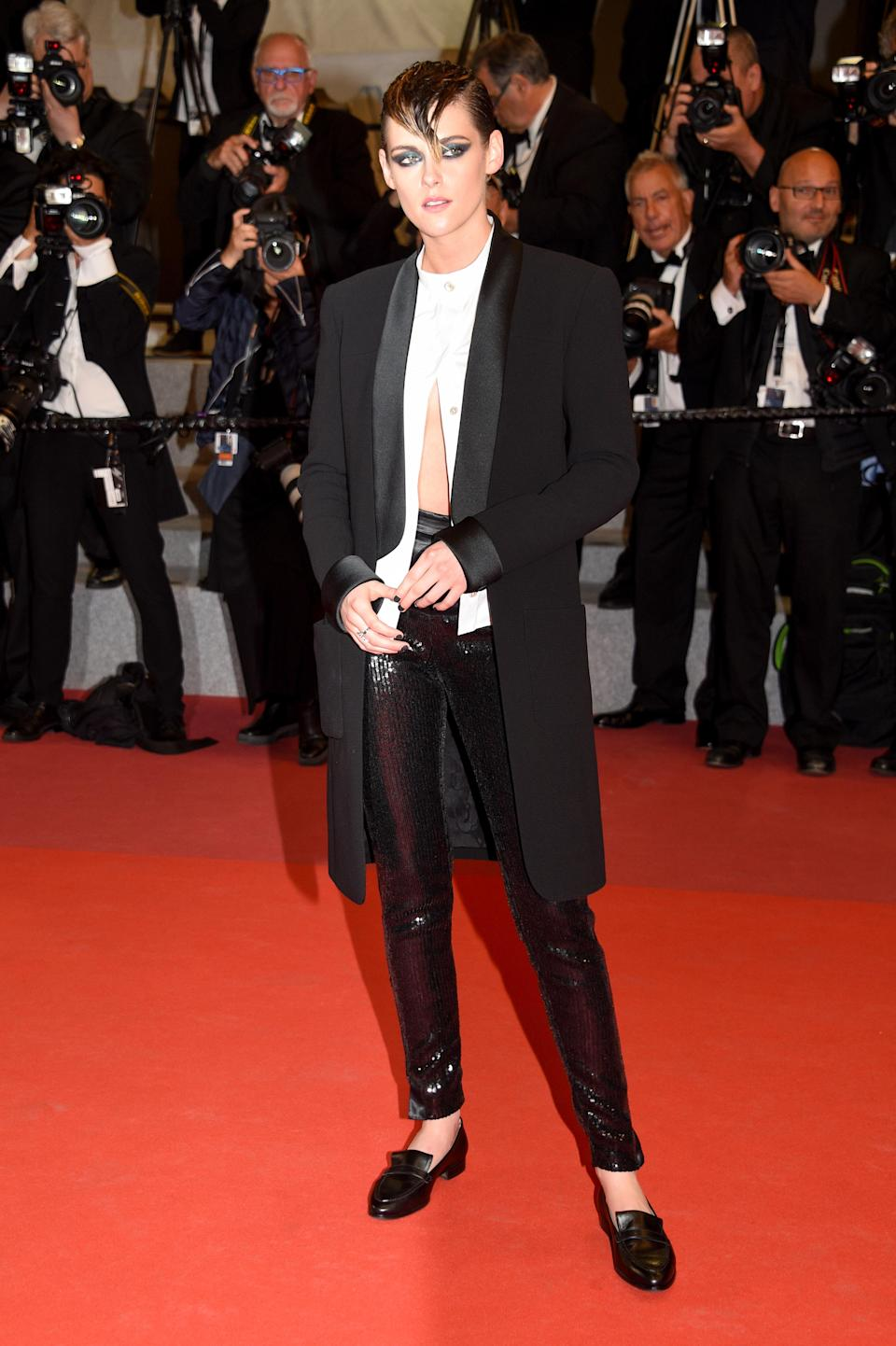 <p>Kristen Stewart looked seriously cool in a tux-style Chanel look finished with leather-look trousers for the premiere of 'Knife + Heart'. [Photo: Getty] </p>