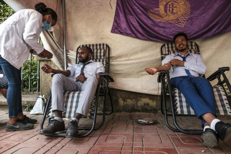 A nurse assists people in Gondar donating blood for Ethiopia's federal forces