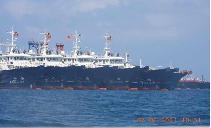 Some of the about 220 vessels reported by the Philippine Coast Guard are pictured at Whitsun Reef, South China Sea