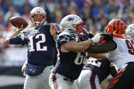 Oct 16, 2016; Foxborough, MA, USA; New England Patriots quarterback Tom Brady (12)  makes a pass while protected from Cincinnati Bengals defensive tackle Geno Atkins (97) by center David Andrews (60) during the second quarter at Gillette Stadium. Mandatory Credit: Greg M. Cooper-USA TODAY Sports