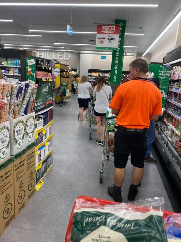 Shoppers are seen queued to the back of the frozen section at Woolworths in Glenrose.