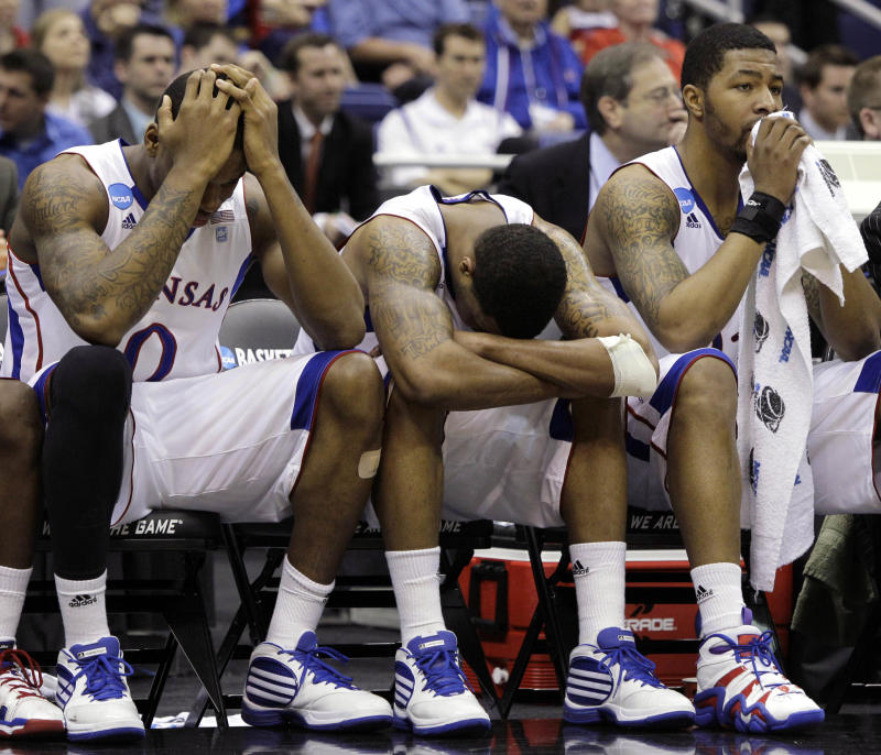 From left to right, Kansas players Thomas Robinson, Marcus Morris and Markieff Morris react in the final moments against Virginia Commonwealth at the Southwest regional final game in the NCAA college basketball tournament on Sunday, March 27, 2011, in San Antonio. VCU won 71-61. (AP Photo/Tony Gutierrez)