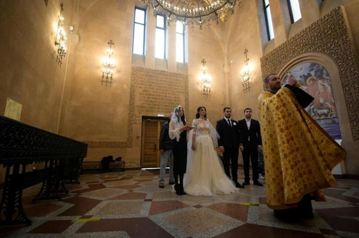 A wedding ceremony at an Armenian Christian church in Moscow on October 20, 2020.
