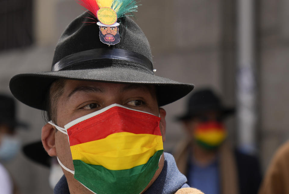 A performer wears a mask with a Bolivian flag motif, due to the COVID-19 pandemic, as he dances on the National Day of the Morenada Dance in La Paz, Bolivia, Tuesday, Sept. 7, 2021. La Morenada is a folk dance from the Andes that was inspired by slaves brought to the region during the colonial era. (AP Photo/Juan Karita)