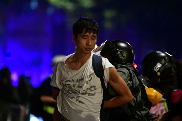 Riot police detain another pro-democracy demonstrator in Hong Kong on Monday (AFP Photo/Anthony WALLACE)