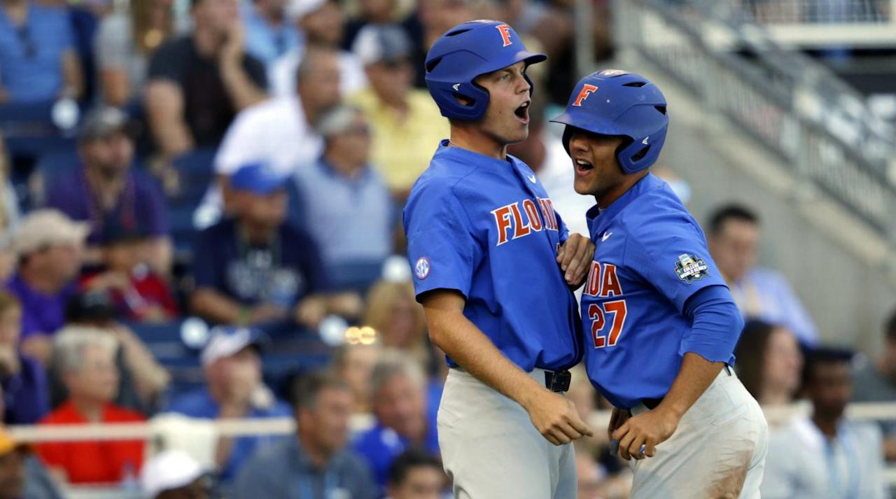 "<p>Behind a dominant performance by righty Brady Singer, who set a College World Series finals record with 12 strikeouts, the Florida Gators are one win a way from their first CWS championship. The Gators defeated their SEC rivals, the LSU Tigers, in the first game of the best-of-three finals on Monday night at Omaha's TD Ameritrade Park, 4-3.</p><p>Singer, 6-foot-5 sophomore who was a second-round 2015 pick by the Blue Jays out of high school, consistently got ahead early in the count with a lively 92-94 mph fastball and then expanded the zone with his slider. He threw 20 first-pitch strikes on the night, netted 16 swings and misses from among his 112 pitches, and scattered eight hits and two walks while allowing three runs in seven-plus innings of work. Michael Byrne, who led the NCAA with 18 saves, pitched the final two innings to seal the victory.</p><p>The Gators, who have been to Omaha 11 times and lost in the finals in 2005 and '11, advanced by beating TCU on Saturday night. The Tigers, who have won six titles, most recently in 2009, beat No. 1 seed Oregon State to advance. The two SEC rivals faced each other back in late March in Gainesville, with Florida taking two out of three. Now they have a significant leg up; since 2003, the team winning the first game of the finals has taken the series 10 out of 14 times, seven via sweep.</p><p>Coming into the game, the top story revolved around LSU coach Paul Mainieri's controversial decision to start fifth-year senior Russell Reynolds, a 6-foot-1 righty who hadn't started a game since March 2015 and this year had been lit for an 8.59 ERA in 14 relief outings totaling 14 2/3 innings. By doing so, he would give an extra day of rest to Game 2 starter Jared Poché, who threw eight innings and 102 pitches last Wednesday (June 21) and Game 3 starter Alex Lange, who threw 7 1/3 innings and 115 pitches on Friday (June 23).</p><p>For a while, the gambit paid off. Reynolds, who hadn't gone longer than 1 2/3 innings in any outing this season, allowed just a pair of singles through the first 3 1/3 innings, and catcher Michael Papierski erased both, gunning down shortstop Dalton Guthrie and centerfielder Ryan Larson as they attempted to steal, the latter on a pitchout. Reynolds got only two swings and misses in that span, and threw first-pitch strikes to just three of those 10 hitters, but he struck out two, both looking, and benefited from centerfielder Zach Watson running down Florida designated hitter Christian Hicks' third-inning drive at the warning track.</p><p>But Reynolds couldn't find the plate in his second time through the order, generally missing glove side with his fastball. With one out in the fourth, he walked Guthrie, first baseman JJ Schwarz and rightfielder Nelson Maldonado, Florida's 2-3-4 hitters, at one point throwing seven straight balls. Finally, Mainieri turned to freshman lefty Nick Bush, and it didn't go well. Shortstop Kramer Robertson made an excellent over-the-shoulder catch of a ball off the bat of Florida leftfielder Austin Langworthy deep in the park's ample foul territory, but Guthrie tagged up and scored easily, and the other two runners advanced as well when Robertson threw home wildly instead of throwing to third. Third baseman Jonathan India brought both home with a ground rule double to centerfield, giving Florida a 3-0 lead.</p><p>""I got a little greedy, trying to squeeze one more inning out of [Reynolds] there,"" conceded Mainieri during the in-game ESPN interview. ""He kind of lost command and walked three batters.""</p><p>Singer was electrifying early, whiffing five through the first three innings while allowing just one hit and a walk. After allowing back-to-back singles to leftfielder Antoine Duplantis and rightfielder Greg Deichmann to start the fourth, he recovered to strike out Watson, third baseman Josh Smith and DH Beau Jordan on a combined 12 pitches to escape the jam.</p><p>He finally faltered in the sixth, serving up a solo homer to rightfield to Duplantis, then loading the bases with two outs via a hit by pitch, a walk and an RBI single from that same Watson-Smith-Jordan trio. With his pitch count at 92, he retired Papierski, who on Saturday against Oregon State became the first player in CWS history to homer from both sides of the plate, on a popup that very nearly fell into no-man's land in shallow leftfield before being snagged by a charging Langworthy.</p><p>As so often happens, Langworthy led off the seventh, and he helped restore Florida's lead by ripping a double into the right-center gap, taking third on a sacrifice and scoring on catcher Mike Rivera's single. Rivera got as far as third base via a productive out and a wild pitch before reliever Hunter Newman escaped by whiffing second baseman Deacon Liput.</p><p>The insurance run proved important. Singer, who convinced coach Kevin O'Sullivan to leave him in for one more batter, began the eighth by getting ahead of Deichmann 0-2 before yielding a hustle double on his 112th and final pitch of the night. Byrne, who made first-team All-American as a sophomore, allowed a liner into the right-center gap by Smith. Deichmann scored, but Smith was thrown out advancing to second base on a great throw by centerfielder Nick Horvath, who had entered the game as a pinch runner in the top of the frame.</p><p>But LSU could get no closer. Byrne got Jordan to ground out, then worked a 1-2-3 ninth to nail down the win for Florida.</p><p>The Gators will send freshman righty Tyler Dyson to the mound for Game 2 on Tuesday, in just his second start of the year. LSU will counter with senior lefty Poché, who holds the school record with 39 career wins.</p>"