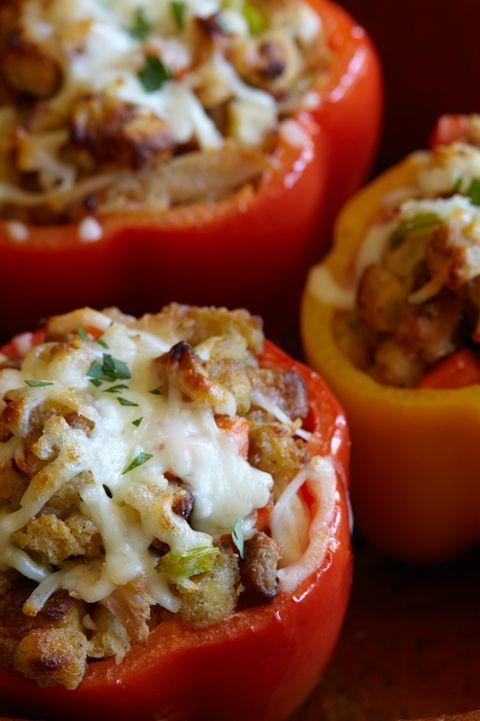 """<p>These are just like the stuffed peppers you love except done Thanksgiving style (and topped with mozzarella, of course).</p><p><a href=""""https://www.delish.com/holiday-recipes/thanksgiving/recipes/a44319/leftover-turkey-and-stuffing-stuffed-peppers/"""" rel=""""nofollow noopener"""" target=""""_blank"""" data-ylk=""""slk:Get the recipe from Delish »"""" class=""""link rapid-noclick-resp""""><em>Get the recipe from Delish »</em></a> </p>"""