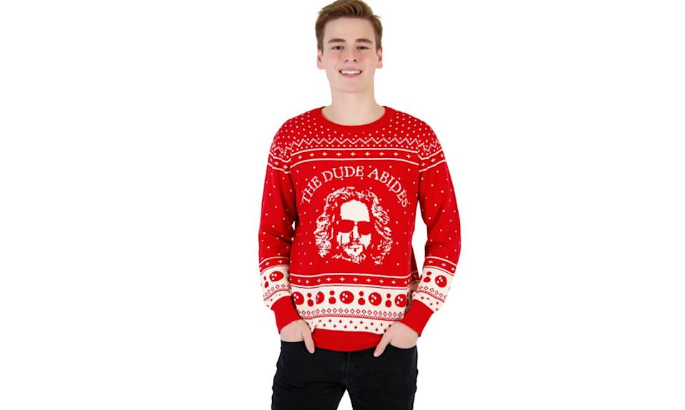 """<p>The Dude abides. And find another sweater that has cute little bowling balls on it. <a rel=""""nofollow noopener"""" href=""""http://www.uglychristmassweater.com/product/the-big-lebowski-the-dude-abides-ugly-christmas-sweater/"""" target=""""_blank"""" data-ylk=""""slk:Buy here"""" class=""""link rapid-noclick-resp""""><strong>Buy here</strong></a> </p>"""