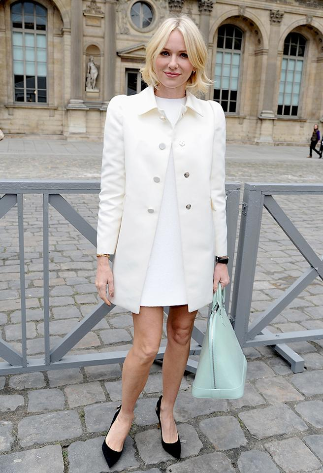 "Also spotted in France during Fashion Week was recent Oscar nominee Naomi Watts (""The Impossible""), who looked chic in a simple Louis Vuitton shift dress and ivory-colored coat. As for her accessories... the black pumps were a bit jarring, but the mint-hued handbag was to die for. Don't you think? (3/6/2013)"