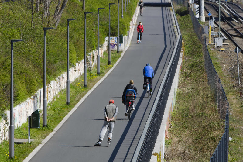 Berlin, Germany - April 16: Cyclists ride on a bicycle road along a railway on April 16, 2019 in Berlin, Germany. (Photo by Thomas Trutschel/Photothek via Getty Images)