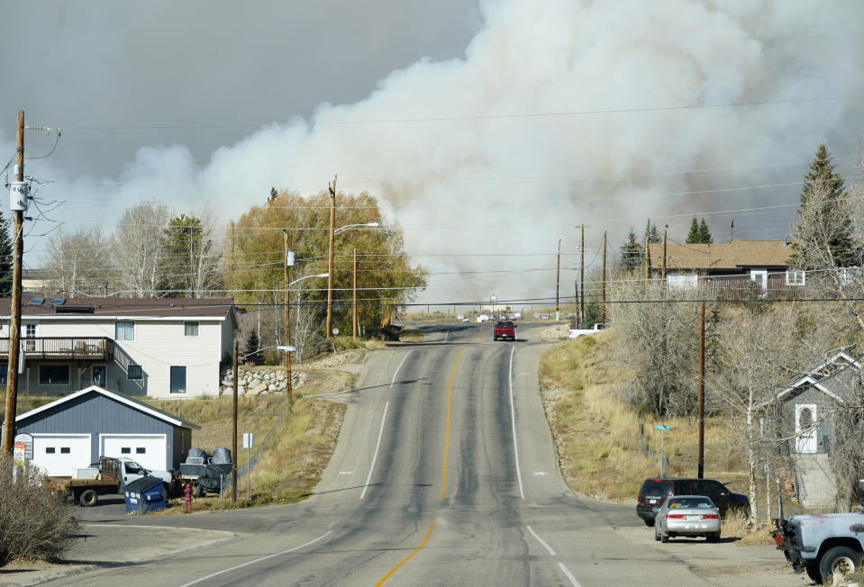 Smoke from wildfires rises in the background near Granby, Colorado.