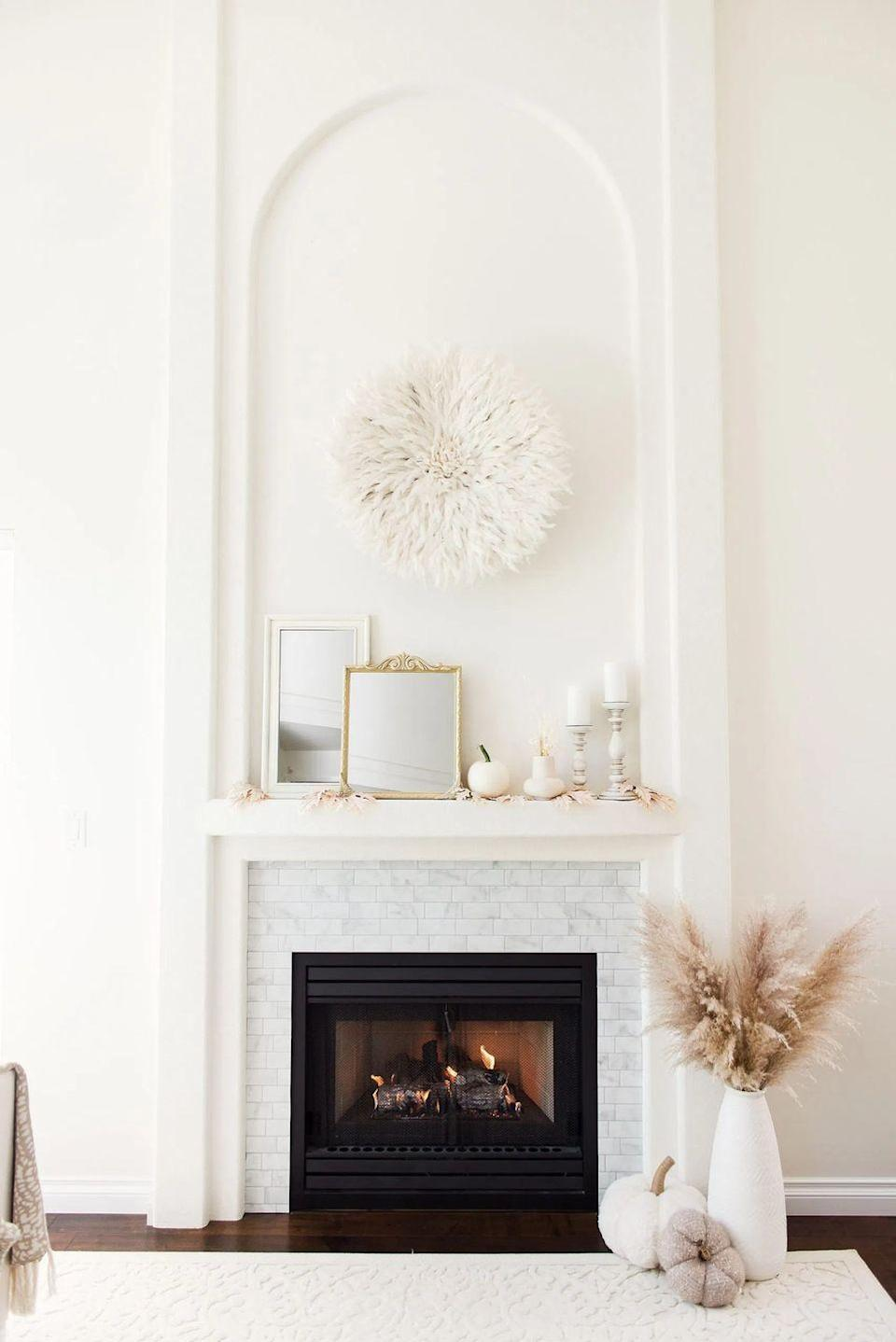 """<p>In a gold hue, this spray-painted mirror will certainly bring some warmth and glam to your fall decorations. Make it look extra-fancy with wood appliqués at the corners. </p><p><strong>Get the tutorial at <a href=""""https://lifeisbetterathome.com/2020/09/16/elegant-fall-mantel-with-neutral-accents/"""" rel=""""nofollow noopener"""" target=""""_blank"""" data-ylk=""""slk:Judy Dill"""" class=""""link rapid-noclick-resp"""">Judy Dill</a>.</strong></p><p><a class=""""link rapid-noclick-resp"""" href=""""https://go.redirectingat.com?id=74968X1596630&url=https%3A%2F%2Fwww.walmart.com%2Fip%2F4pcs-set-Wood-Carved-Corner-Onlay-Applique-Unpainted-Frame-Cupboard-Cabinet-Decal-For-Home-Furniture-Decor-Craft-8x8cm%2F830107645&sref=https%3A%2F%2Fwww.thepioneerwoman.com%2Fhome-lifestyle%2Fcrafts-diy%2Fg36891743%2Ffall-mantel-decorations%2F"""" rel=""""nofollow noopener"""" target=""""_blank"""" data-ylk=""""slk:SHOP WOOD APPLIQUÉS"""">SHOP WOOD APPLIQUÉS</a></p>"""