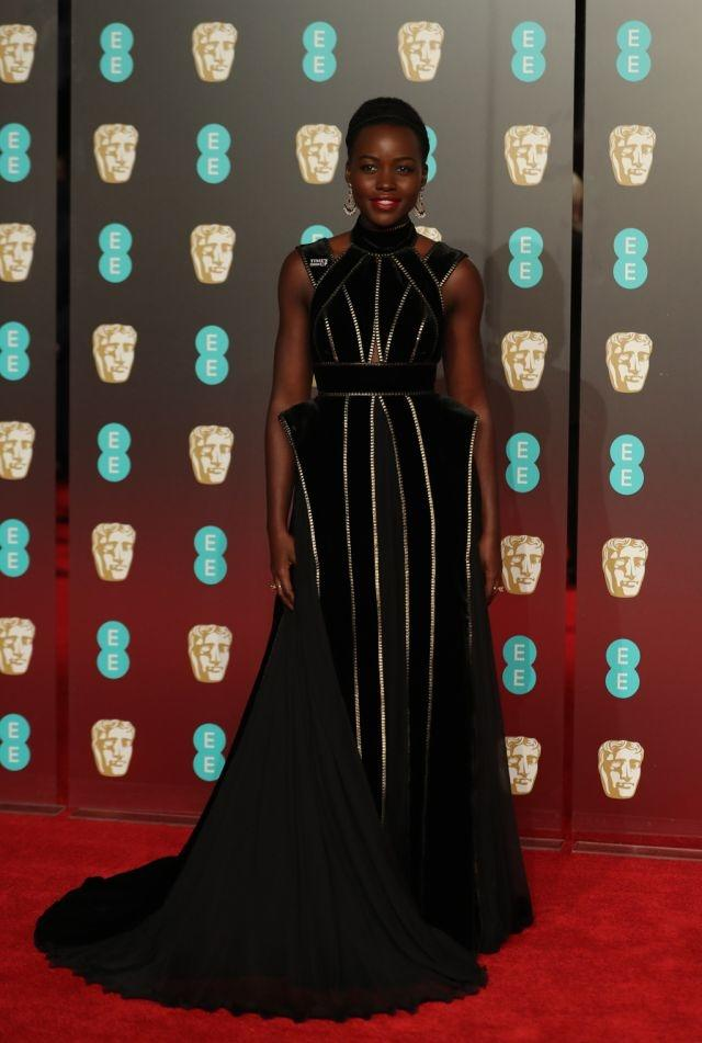 Never a fashion faux pas from Lupita Nyong'o, who once again scores a hit with her natural elegance and charisma in this Elie Saab dress with gold-edged bands. BAFTAs, London, February 18, 2018