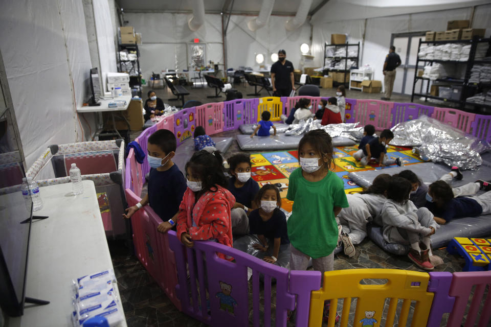 Young unaccompanied migrants, ages 3-9, watch TV inside a playpen at the Donna Department of Homeland Security holding facility, the main detention center for unaccompanied children in the Rio Grande Valley in Donna, Texas, March 30, 2021. The youngest of the unaccompanied minors are kept separate from the rest of the detainees. (Dario Lopez-Mills /POOL/AFP via Getty Images)