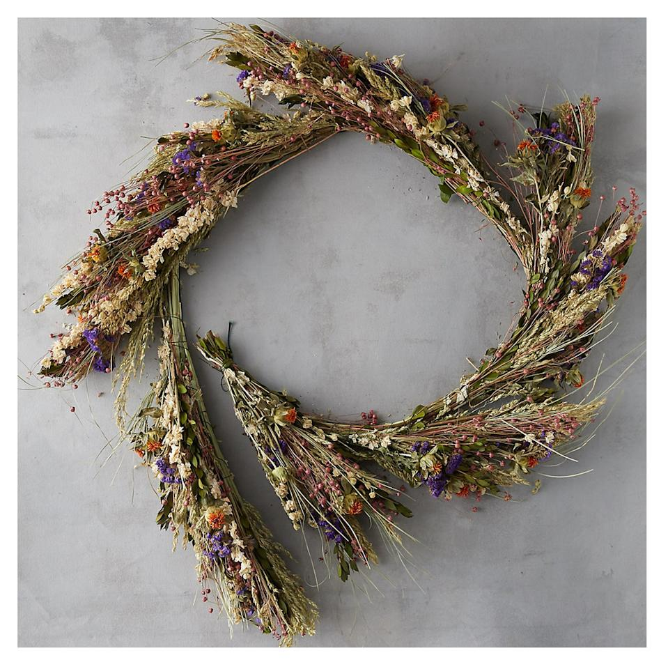 """<p>Rustic and elegant, this dried wildflower garland would make the prettiest fall mantelpiece embellishment or Thanksgiving table runner.</p> <p><strong>To buy:</strong> $148; <a href=""""https://www.shopterrain.com/products/dried-wild-flower-garland"""" target=""""_blank"""">shopterrain.com</a>.</p>"""