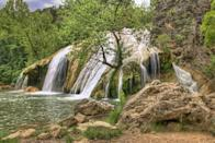 """<p>Davis is best experienced outdoors — and they couldn't be greater here. This small town boasts one of the state's tallest waterfalls at <a href=""""http://www.travelok.com/davis"""" rel=""""nofollow noopener"""" target=""""_blank"""" data-ylk=""""slk:Turner Falls Park"""" class=""""link rapid-noclick-resp"""">Turner Falls Park</a>. Indoor person? Then a visit to <a href=""""http://www.bedrechocolates.com/"""" rel=""""nofollow noopener"""" target=""""_blank"""" data-ylk=""""slk:Bedré Chocolates"""" class=""""link rapid-noclick-resp"""">Bedré Chocolates</a> belongs on your to-do list. </p><p><a href=""""https://www.housebeautiful.com/lifestyle/g3228/famous-waterfalls/"""" rel=""""nofollow noopener"""" target=""""_blank"""" data-ylk=""""slk:See the most famous waterfalls in the world »"""" class=""""link rapid-noclick-resp""""><em>See the most famous waterfalls in the world »</em></a></p>"""