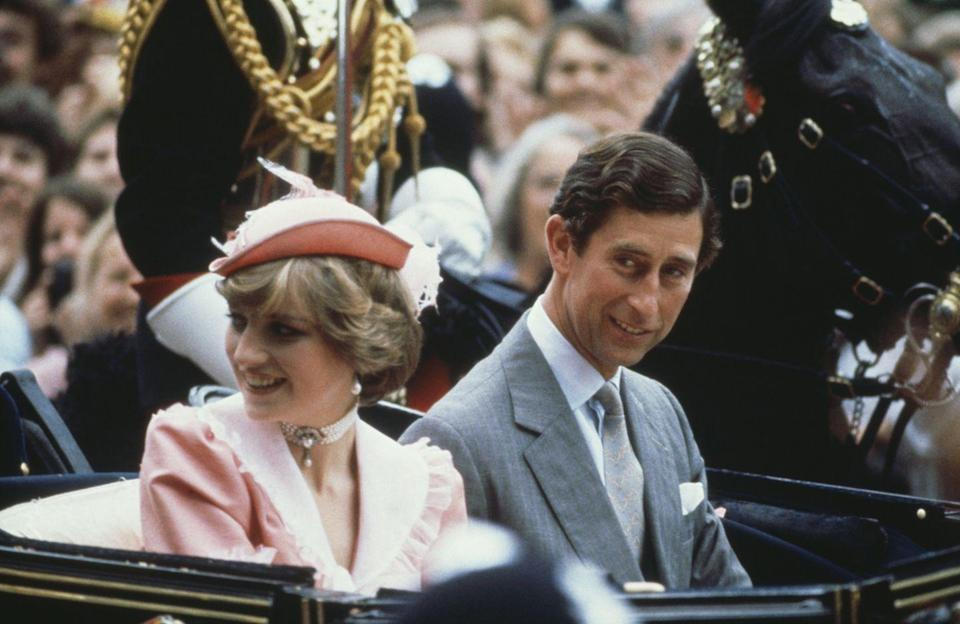 """<p>While she wore the sparkling Spencer tiara on her wedding day, Princess Diana chose to wear a dainty peach-colored topper as she left on her honeymoon with Prince Charles.</p><p><strong><a href=""""https://www.townandcountrymag.com/style/jewelry-and-watches/a15908164/meghan-markle-wedding-tiara/"""" rel=""""nofollow noopener"""" target=""""_blank"""" data-ylk=""""slk:More: 4 Tiaras Meghan Markle Could Wear on Her Wedding Day"""" class=""""link rapid-noclick-resp"""">More: 4 Tiaras Meghan Markle Could Wear on Her Wedding Day</a></strong><br></p>"""