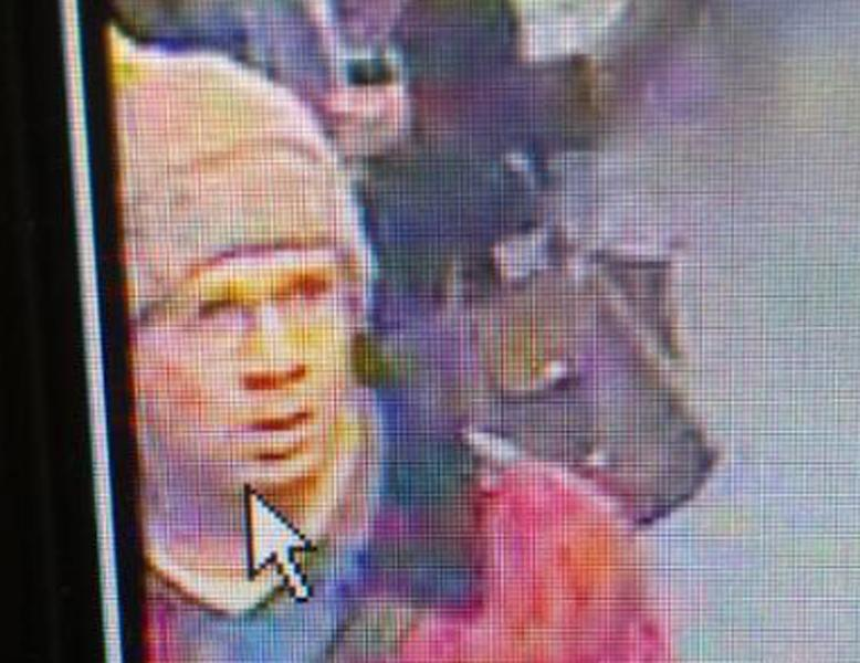 This photo dated Monday, Nov. 18, 2013, taken from the footage of a security camera and released by the Paris Prefecture de Police on Tuesday, Nov. 19 2013, shows the alleged gunman walking at the Concorde underground station in Paris, France. French police are hunting for a gunman suspected in a shooting Monday at a Paris newspaper office that gravely wounded a photographer, as well as three other attacks around the nation's capital. The motive for the attacks, which prompted heightened security at media offices and the busy Champs-Elysees shopping avenue, is unclear.( AP Photo/Prefecture de Police)