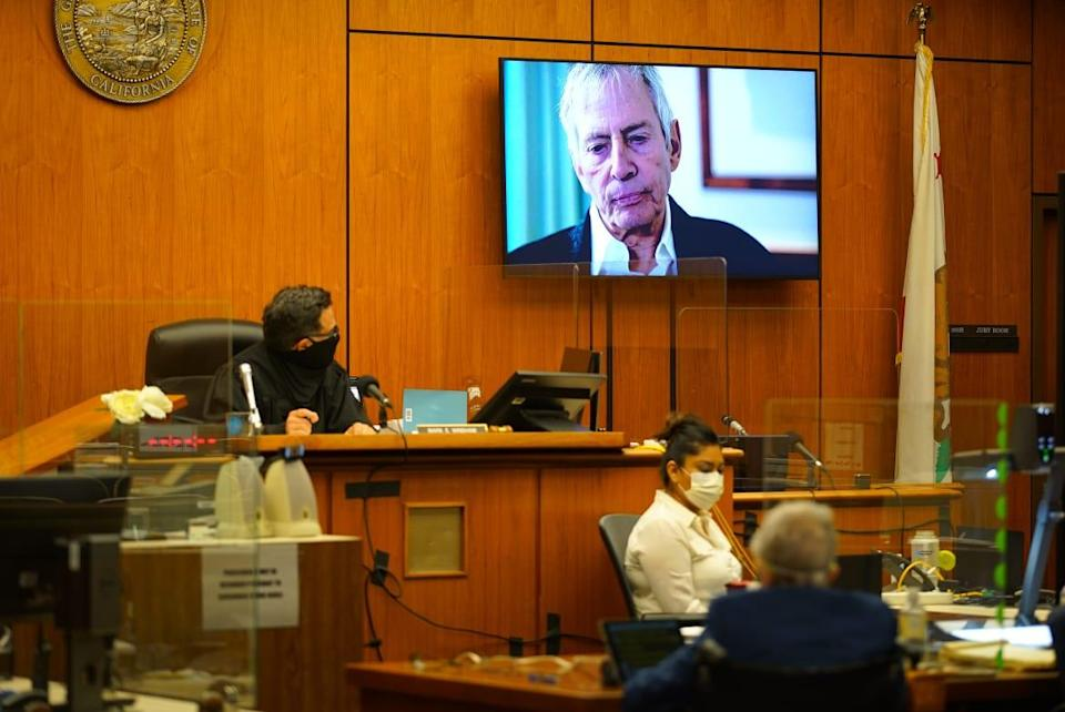 """<div class=""""inline-image__caption""""><p>A TV still of Robert Durst from """"The Jinx"""" appears on screens during his trial.</p></div> <div class=""""inline-image__credit"""">Pool/Getty</div>"""