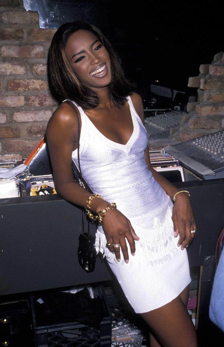 <p>Seen here in 1990 in New York City, Naomi Campbell looks flawless and so happy in her white-fringed outfit. </p>