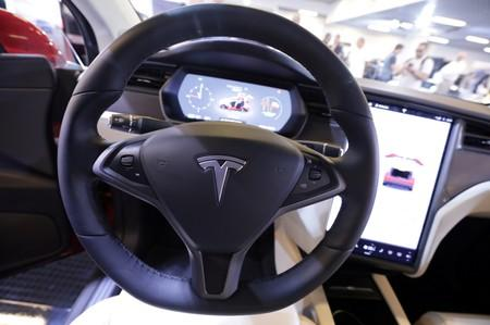 FILE PHOTO: The logo of Tesla carmaker is seen inside a car at the Top Marques fair in Monaco