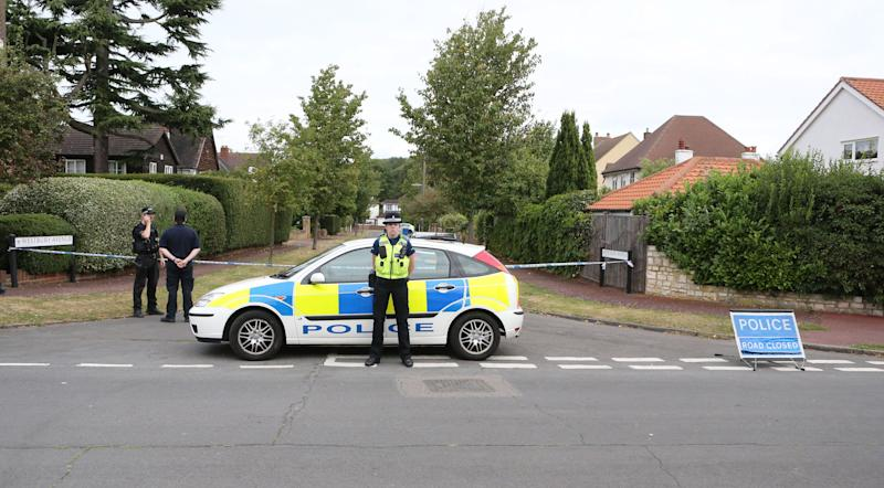 The home of Saad al-Hilli, in Claygate, England, who was shot dead with three others while vacationing in the French Alps, continues to be guarded by Surrey Police, who are assisting French police, Monday Sept. 10, 2012. Authorities say they are probing whether an alleged financial dispute between Saad al-Hilli and his brother Zaid played a role, though the surviving brother has denied any conflict. (AP Photo/PA, Steve Parsons) UNITED KINGDOM OUT NO SALES NO ARCHIVE