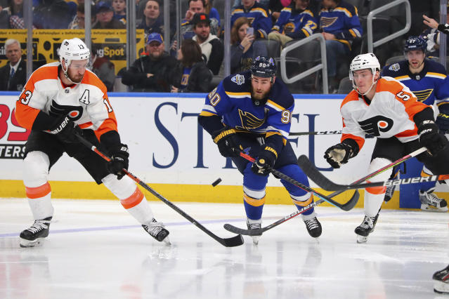 Philadelphia Flyers center Kevin Hayes (13) and center Philippe Myers (5) defend against St. Louis Blues center Ryan O'Reilly (90) during the second period of an NHL hockey game Wednesday, Jan. 15, 2020 in St. Louis. (AP Photo/Dilip Vishwanat)