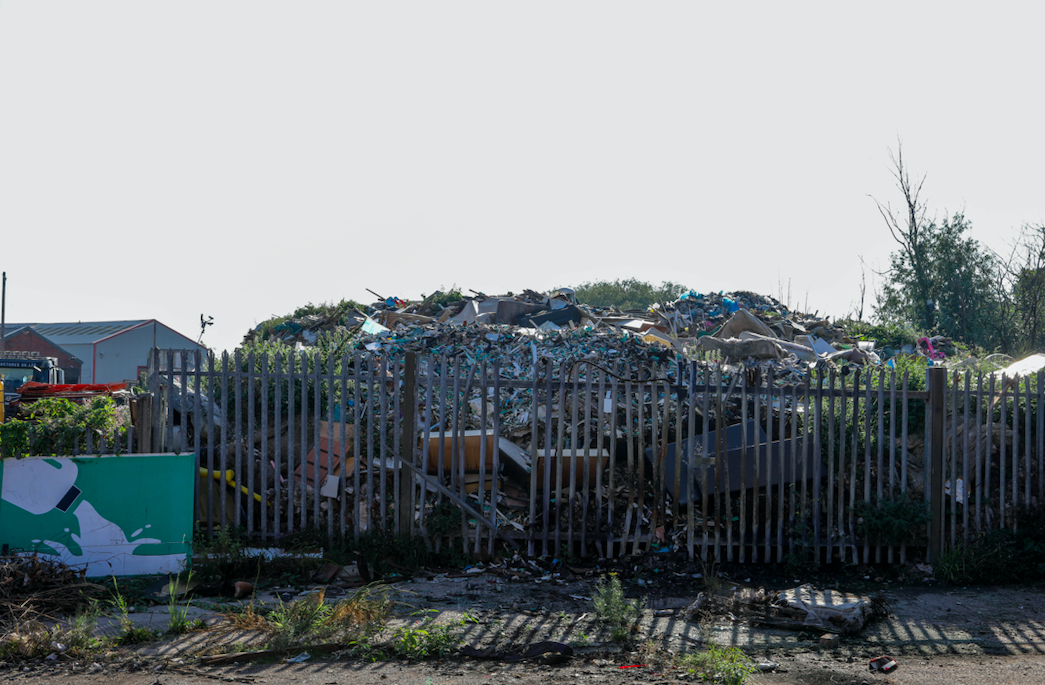 Homeowners say the eyesore has left their housing estate in Willenhall, West Mids., looking like a 'third world slum'. (SWNS)