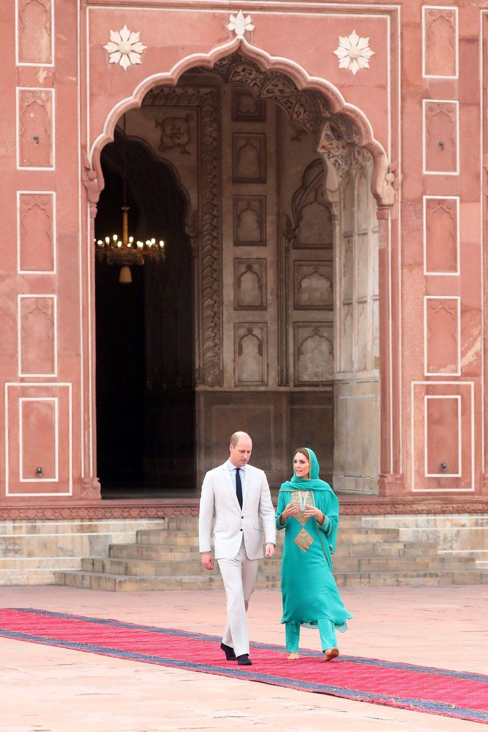 <p>While visiting Pakistan on an official royal tour, Kate Middleton and Prince William visited the Badshahi Mosque within the Walled City of Lahore. The couple adhered to the mosque's dress code and removed their shoes before entering. </p>