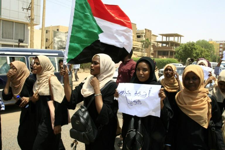 Protesters carried the Sudanese flag as they demonstrated against the killing of students