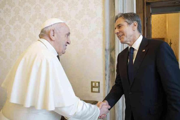 Pope Francis shakes hands with Secretary of State Antony Blinken, as they meet at the Vatican, Monday, June 28, 2021. Blinken is on a week long trip in Europe traveling to Germany, France and Italy. (Vatican Media via AP Photo)